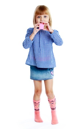 Charming little girl holding a pink cube.Education concept happy child. photo
