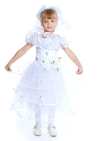 snow queen: Little girl dressed as a white princess.Isolated on white background. Stock Photo