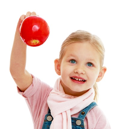 Little girl holding a red apple.Childhood education development in the Montessori school concept. Isolated on white background. photo