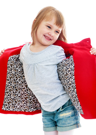 very fashionable little girl in a bright red coat Happy childhood, fashion, autumnal mood concept. Isolated on white background photo