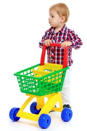 Little boy playing in the store.Early years learning a happy childhood concept.Isolated on white . photo