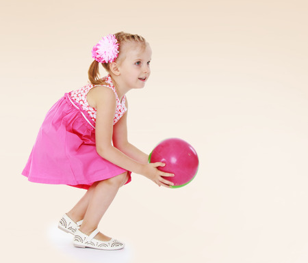 Charming little girl playing.Happiness, winter holidays, new year, and childhood. photo