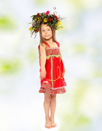3 persons only: Little girl in a wreath and a red dress.