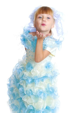 Charming girl in white and blue dress. holiday, baby joy concept . photo