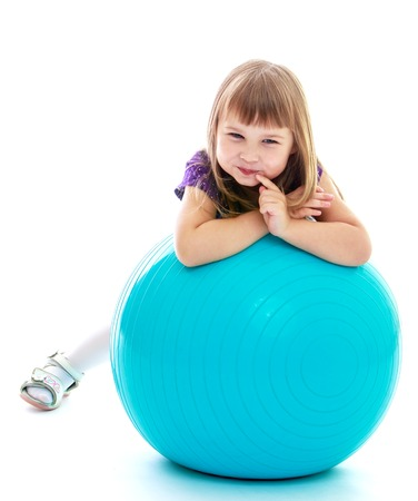 Positive little girl sports ball. Happy childhood, fashion, autumnal mood concept. Isolated on white background photo