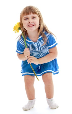 baby 4 5 years: Happy girl with a yellow flower on a white background