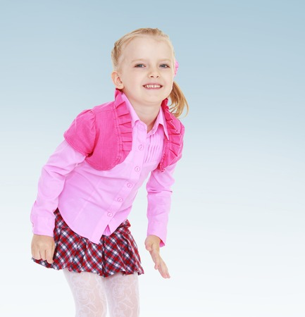 6 7 years: Cheerful little girl in a pink jacket having fun smiling.