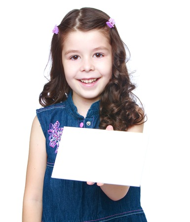 Positive little girl holds up a white envelope.Isolated on white background. photo