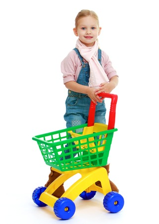 nursing department: Charming little girl with a toy truck.Childhood education development in the Montessori school concept. Isolated on white background.