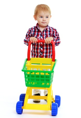 Little boy playing in the store.Early years learning a happy childhood concept.Isolated on white background. photo