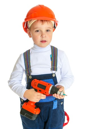apprenticeships: Apprenticeships, child labor, the joy of technical knowledge concept.Little boy in the construction helmet holding a screwdriver.