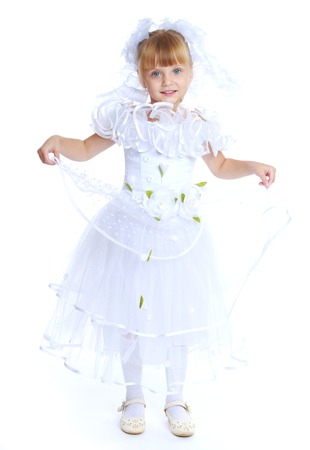 snow queen: Preparing for Christmas, holiday, baby joy concept .Little girl dressed as a white princess.Isolated on white background. Stock Photo