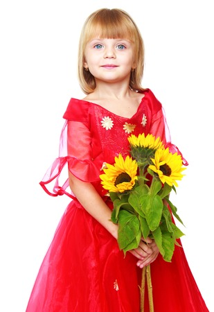 Happy childhood, childrens fashion concept.Happy childhood, childrens fashion concept.Very beautiful little girl with a bouquet of sunflowers.Isolated on white background. photo
