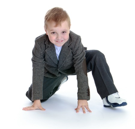 pre adolescent boy: baby fashion concept - little boy in a gray suit. Stock Photo