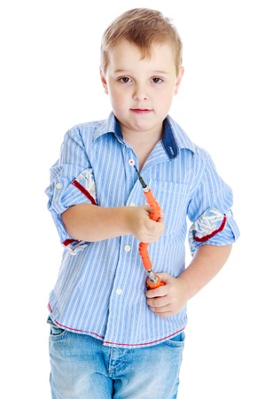 apprenticeships: Apprenticeships, child labor, the joy of technical knowledge concept.Little boy holding a screwdriver.