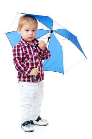 Little boy standing colored umbrella.Early years learning a happy childhood concept.Isolated on white background. photo