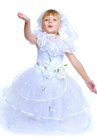 Preparing for Christmas, holiday, baby joy concept .Little girl dressed as a white princess.Isolated on white background. photo
