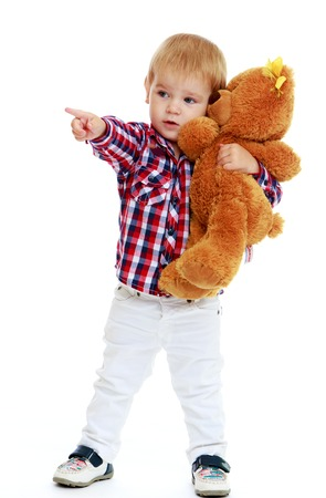 Little boy hugging a teddy bear.Early years learning a happy childhood concept.Isolated on white background. photo