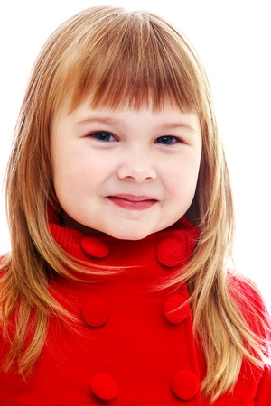 Charming little girl in a red coat close up.Happy childhood, fashion, autumnal mood concept. Isolated on white background photo