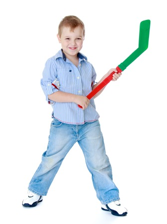 pre adolescent boy: Sports development, training hockey, happy childhood concept.Little boy learning to play hockey.