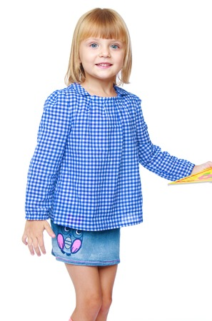 denim skirt: charming little girl in a blue blouse and denim skirt isolated on white background