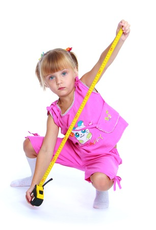 Child development, skills training concept.Little girl with construction tools.Isolated on white background. photo