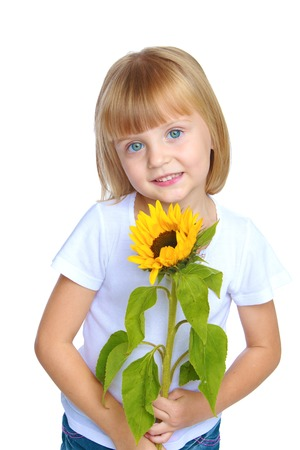 little girl holding a sunflower.Isolated on white background. photo