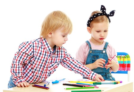 boy and girl draws felt-tip pensChildhood education development in the Montessori school concept. Isolated on white background.