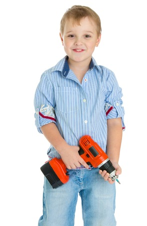 apprenticeships: Apprenticeships, child labor, the joy of technical knowledge concept.Little boy where in the hands of an electric screwdriver.