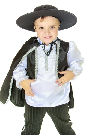 pre adolescent boy: Theatrical productions, childrens fashion, child development concept.little boy in the big wide-brimmed hat and theatrical costumes.