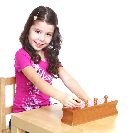 Girl for employment in the Montessori classroom.White background, isolated photo. photo
