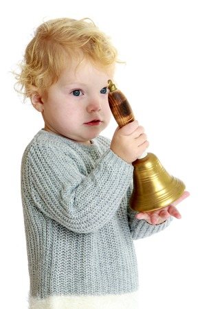 girl with rings: Young little girl rings the bell.White background, isolated photo.