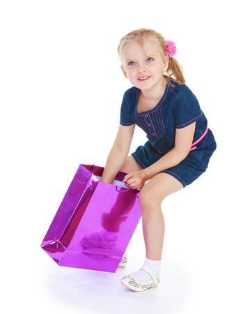 girl with a big bag for gifts.White background, isolated photo. photo