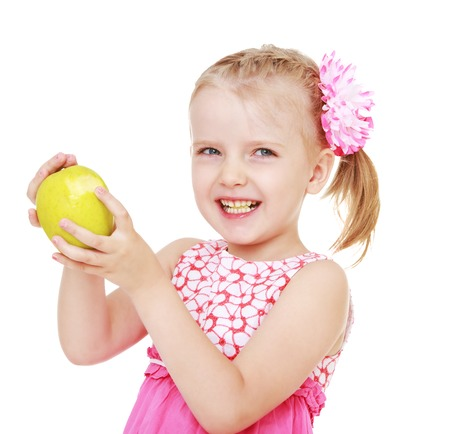 beautiful cheerful girl with a big green apple.White background, isolated photo. photo