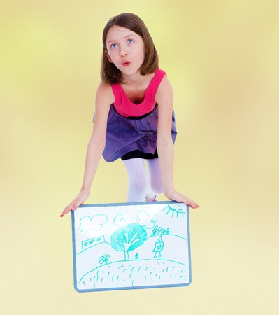 baby 4 5 years: little girl shows off her figure that drew on the banner Stock Photo