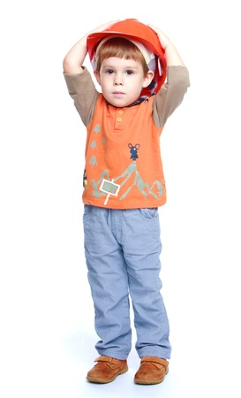 baby 4 5 years: Cheerful little boy in the construction helmet.Isolated on white background portrait. Stock Photo