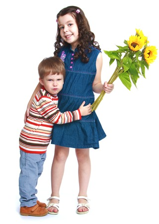 baby 4 5 years: Little brother embracing his sister who is holding a bouquet of flowers.Isolated on white background portrait.
