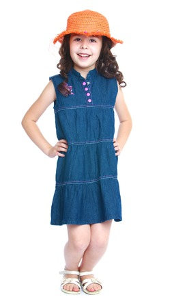 baby 4 5 years: Girl denim dress sat poses for the camera.Isolated on white background portrait.