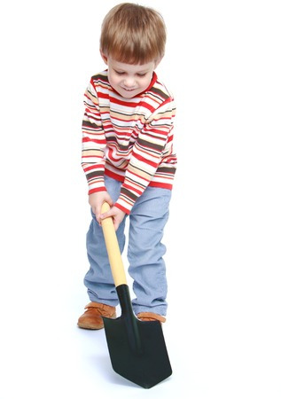 baby 4 5 years: Little boy holding a shovel.Isolated on white background portrait.