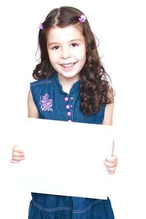baby 4 5 years: Girl in jeans dress holding a banner in front.Isolated on white background portrait.
