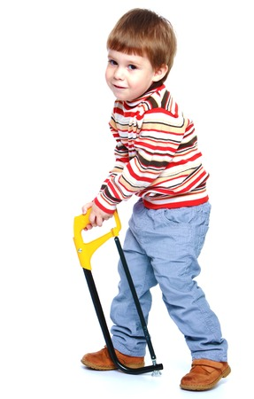 baby 4 5 years: Little boy holding a saw.Isolated on white background portrait.