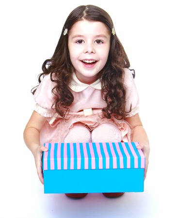 baby 4 5 years: Charming girl holding a box.Isolated on white background portrait.