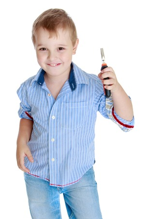 Apprenticeships, child labor, the joy of technical knowledge concept.Little boy holding a wire cutter. Stock Photo