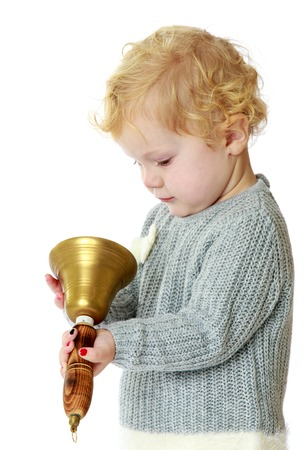 girl with rings: little girl rings the bell ringing. Isolated on white background studio photo. Stock Photo