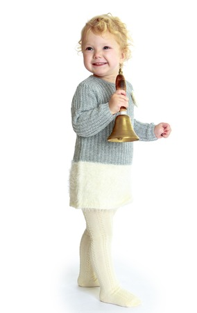 girl with rings: Girl rings the bell. Isolated on white background studio photo.