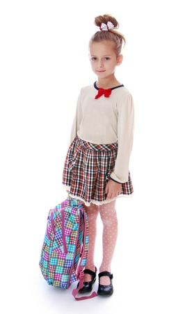classbook: beautiful girl holding a schoolbag.Isolated on white background.