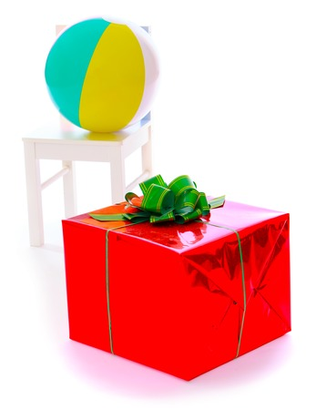 beautifully wrapped: Beautifully wrapped gift, a ball and a chair.Isolated on white background.