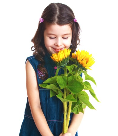 Adorable little girl is smelling flowers.Isolated on white background, Lotus Childrens Center. photo