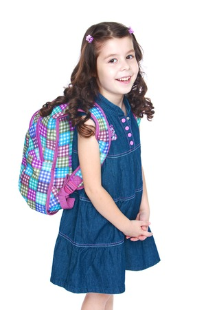knapsack: Beautiful little schoolgirl with a knapsack on his shoulders.Isolated on white background, Lotus Childrens Center.