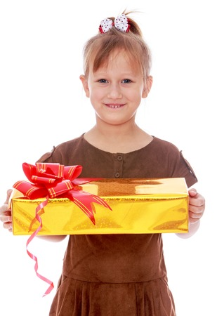 beautifully wrapped: Happy childhood, the family concept.Smiling little girl holds up a beautifully wrapped gift. Isolated on white.